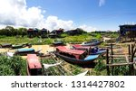 traditional wooden boats... | Shutterstock . vector #1314427802