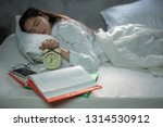 asian young woman with alarm...   Shutterstock . vector #1314530912
