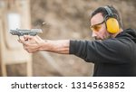 detail view of shooter holding... | Shutterstock . vector #1314563852