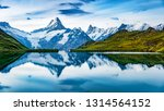 Panoramic summer view of Bachalpsee lake with Schreckhorn and Wetterhorn peaks on background. Gloomy outdoor scene of Swiss Bernese Alps, Switzerland, Europe.  - stock photo