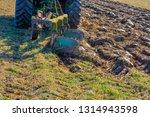 tractor with plough  plow ... | Shutterstock . vector #1314943598