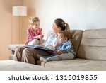 happy mother enjoying day with... | Shutterstock . vector #1315019855