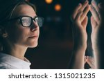 female standing at display with ... | Shutterstock . vector #1315021235