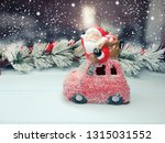 christmas santa on red car toy... | Shutterstock . vector #1315031552