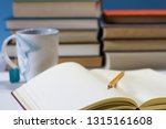 journal in library with mug | Shutterstock . vector #1315161608