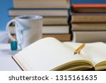 journal in library with mug | Shutterstock . vector #1315161635