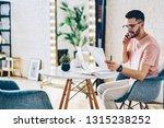 positive man in optical eyewear ... | Shutterstock . vector #1315238252