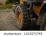 the big yellow wheel of heavy... | Shutterstock . vector #1315271795