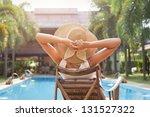 Woman In Hat Taking Sunbath...