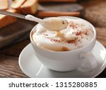 cup of cappuccino coffee on... | Shutterstock . vector #1315280885