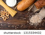 wheat products on dark wooden... | Shutterstock . vector #1315334432