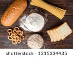 wheat products on dark wooden... | Shutterstock . vector #1315334435