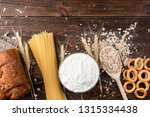 wheat products on dark wooden... | Shutterstock . vector #1315334438