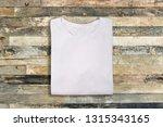 blank white folded t shirt on...   Shutterstock . vector #1315343165