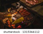 family making barbecue in... | Shutterstock . vector #1315366112