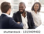 cheerful african and caucasian... | Shutterstock . vector #1315409402