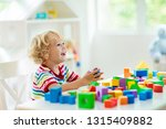 kid playing with colorful toy...   Shutterstock . vector #1315409882