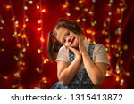 funny girl with funny pigtails... | Shutterstock . vector #1315413872