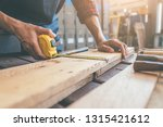 carpenter working with... | Shutterstock . vector #1315421612