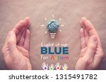 blue paper light bulb with... | Shutterstock . vector #1315491782