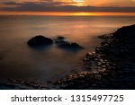 sunset and unique shaped... | Shutterstock . vector #1315497725