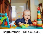 baby girl playing with toys on... | Shutterstock . vector #1315533038