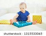 happy baby girl in blue dress... | Shutterstock . vector #1315533065