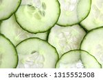 cucumber slices as background | Shutterstock . vector #1315552508