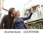 young tourist couple visiting a ... | Shutterstock . vector #131555408