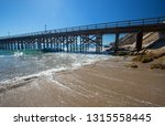 fishing pier and boat hoist at... | Shutterstock . vector #1315558445