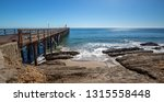 fishing pier and boat hoist at... | Shutterstock . vector #1315558448