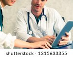 young doctor examining female...   Shutterstock . vector #1315633355