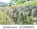 gabion   a metal wire cage... | Shutterstock . vector #1315680665