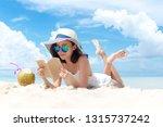 summer vacation. smelling asian ...   Shutterstock . vector #1315737242