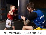 child and instructor in ring... | Shutterstock . vector #1315785038