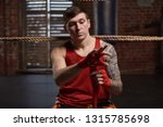 athlete boxer  wraps his hands... | Shutterstock . vector #1315785698