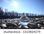 glowing lensball in nature | Shutterstock . vector #1315824275