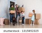 family with cardboard boxes... | Shutterstock . vector #1315852325