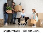 family with cardboard boxes... | Shutterstock . vector #1315852328
