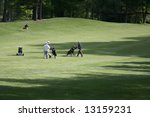 Golfers On A Wooded Golf Course