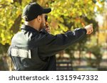 male security guard with... | Shutterstock . vector #1315947332
