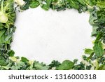 green leaf salad frame on grey... | Shutterstock . vector #1316000318
