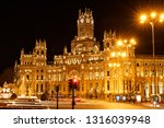 Communication Palace ( Palacio de Cibeles), Madrid. Beautiful night view over The Communication Palace, in Madrid. Also known as Palacio de Cibeles, the traffic in the area just surrounded with lights