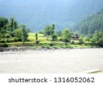 river bank with small village...   Shutterstock . vector #1316052062