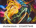 brightly colored woolen ends | Shutterstock . vector #1316057648