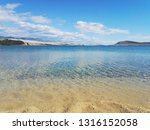 beautiful solitary beach with... | Shutterstock . vector #1316152058