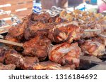 large pieces of meat cooked on... | Shutterstock . vector #1316184692