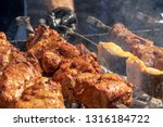 pieces of meat and fish cooked... | Shutterstock . vector #1316184722