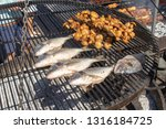 fish and mushrooms are roasted... | Shutterstock . vector #1316184725