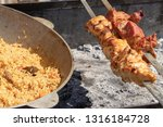 a large cauldron with pilau and ... | Shutterstock . vector #1316184728